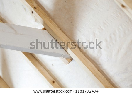 An interior view of unfinished home inside. Finishing made of tongue and groove planks