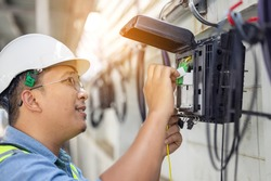 An internet technician is repairing or maintaining a fiber optic connection by opening a fiber optic connector.