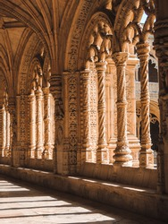 An interplay of light and shadow over the columns of Jeronimos Monastery, Lisbon