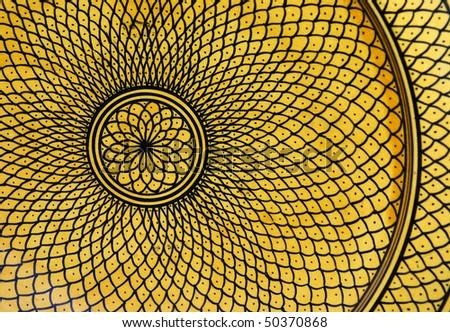 An intricate design on a handmade plate in Marrakech. - stock photo