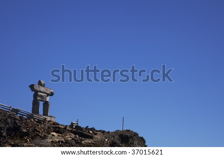 An Inukshuk at the peak of Whistler, British Columbia. - stock photo