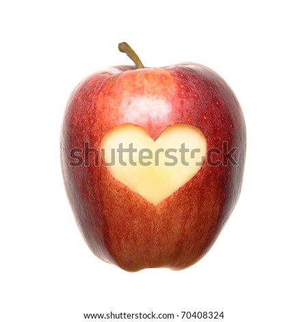 An isolated apple with a carved heart.