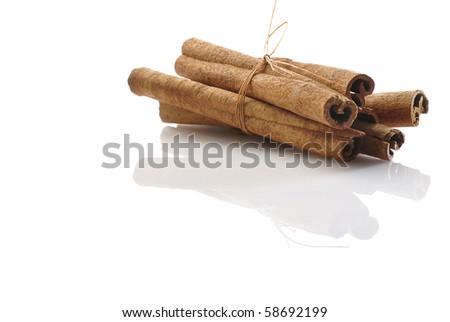 An isolated bunch of cinnamon sticks.