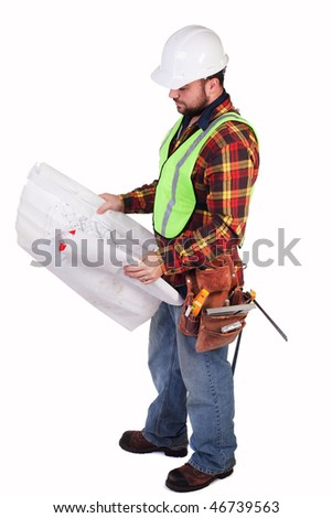 an isolated construction worker looking at some blueprints