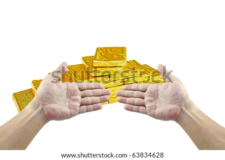 An isolated cutout of a pair of hand gesturing towards a stack of gold bullion.