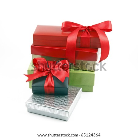 An isolated cutout of a stack of gift box and presents tied with red ribbon bow.