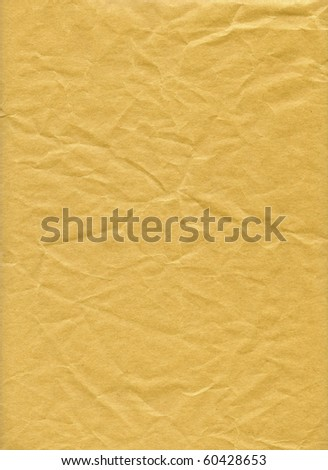 An isolated old grunge yellow paper folded