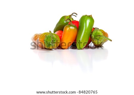 An isolated on white image of jalepenos and peppers. - stock photo