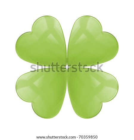 An isolated reflective glass four leaf clover