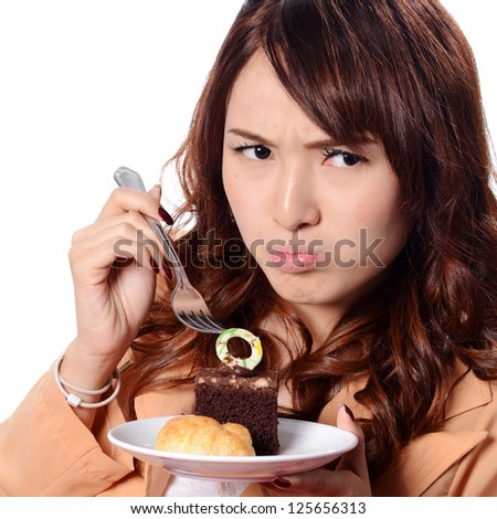 An isolated shot of a beautiful asian woman holding a cake - stock photo