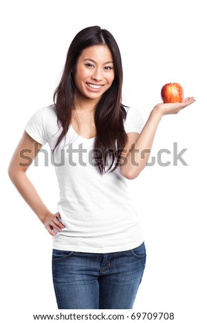 An isolated shot of a beautiful asian woman holding an apple