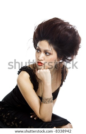 An isolated shot of a beautiful asian woman in a black dress