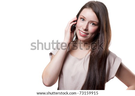 An isolated shot of a beautiful caucasian businesswoman talking on the phone