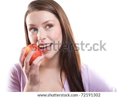 An isolated shot of a beautiful caucasian woman eating an apple