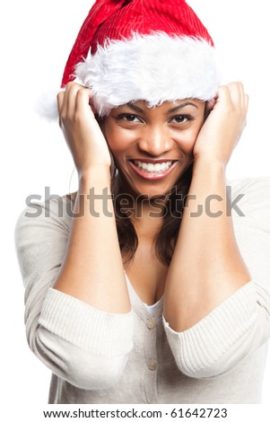An isolated shot of a black woman celebrating christmas wearing santa hat