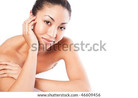 An isolated shot of a black woman lying down at a spa - stock photo
