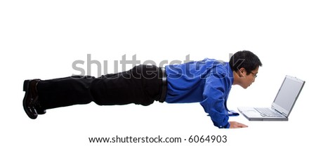 An isolated shot of a businessman doing push up while working on his laptop