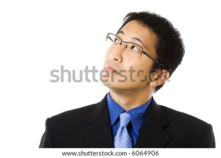 An isolated shot of a businessman looking up