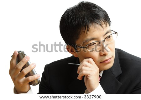 An isolated shot of a businessman planning with his PDA - stock photo