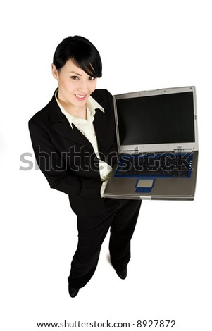 An isolated shot of a businesswoman showing her laptop