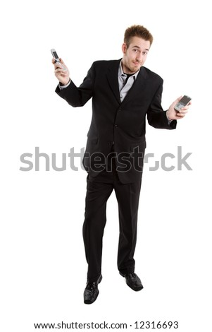 An isolated shot of a busy caucasian businessman holding two cell phones