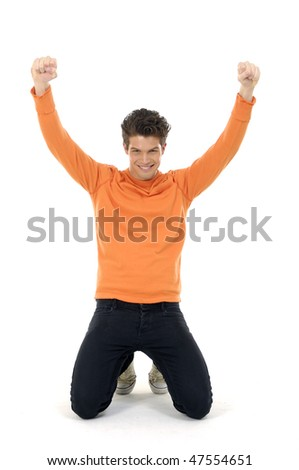 An isolated shot of a happy and young casual caucasian man raising his arms
