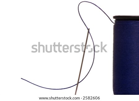 An isolated shot of a needle with blue thread. Preparing for a sewing job