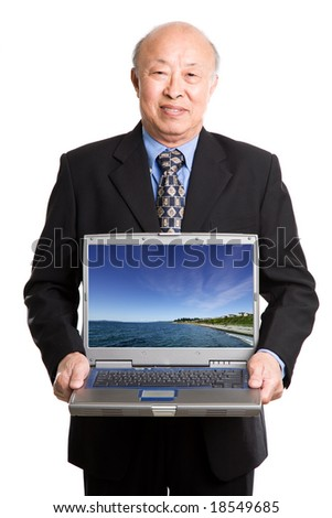 An isolated shot of a senior asian businessman carrying a laptop (Note: image on the laptop is taken by me)
