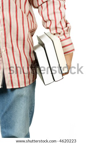 An isolated shot of a young college student carrying books