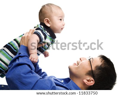 An isolated shot of an asian father playing with his son