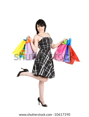 An isolated shot of beautiful woman carrying shopping bags