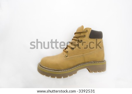 An isolated tan color chunky work boot