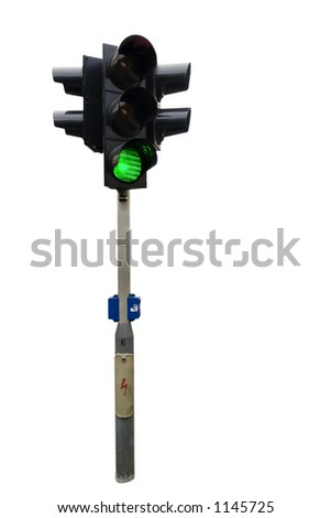An isolated traffic light from Prague with the green light showing