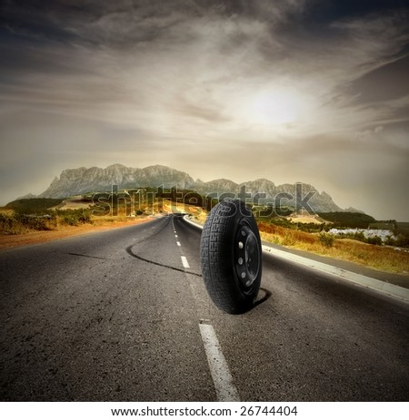 an isolated wheel running on a country road