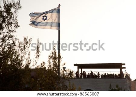 An Israeli flag flies over the Jewish settlement of Beit Hoshen on the Mount of Olives in East Jerusalem.