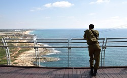 An Israeli soldier looks at Israel's viewpoint from the northernmost point of the country at Rosh Hanikra at the border with the Lebanon