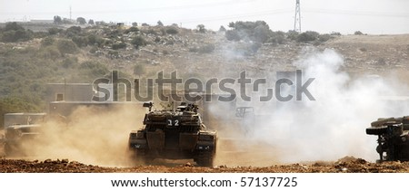 An Israeli tank doing maneuver in open fields and urban area, this is part of regular army training in Israel for regular and reserve soldiers.