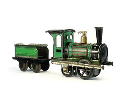 An Issmayer antique clockwork litho printed tinplate toy locomotive and tender on a plain white background.