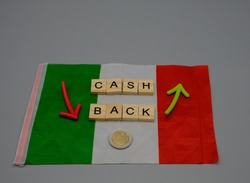 An Italian flag, with cash, back written on it,with two colored arrows and a coin. Concept of incoming and outgoing payments