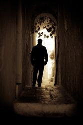 An Italian guy walking alone in a little italian village