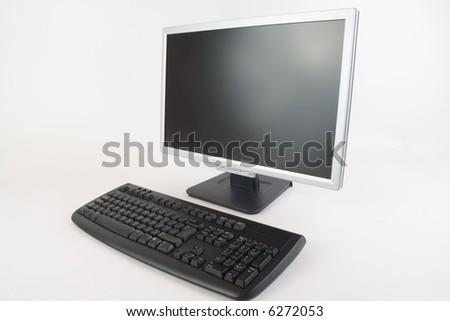 An lcd monitor and keyboard at a 45 degree angle