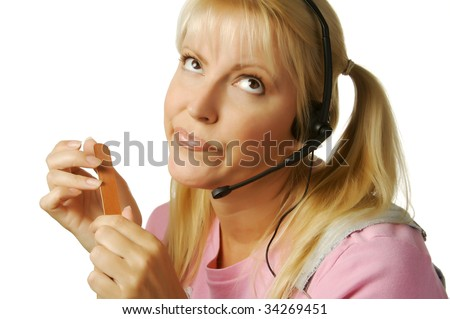 An obviously bored customer support girl waiting for the clock to hit 5:00.