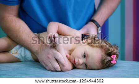 An occupation with baby with cerebral palsy. Physiotherapy Stock photo ©