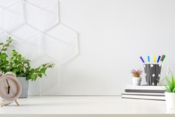 An office by an empty wall. Home Office. School desk. Copy space. Plants at home.