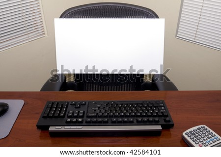 An Office Desk with a Blank Sign Board in the Chair.  Fill in Your Own Text to Express Numerous Business and Employment Issues!