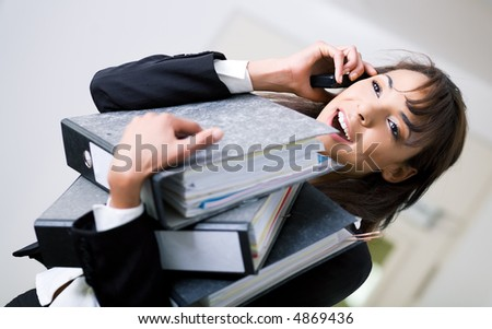An office woman handling simultaneous jobs rather successful