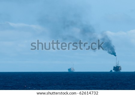 An offshore oil rig burning gas at the horizon.  Coast of Brazil