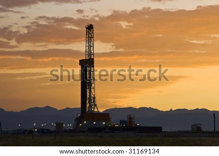 an oil drilling rig in the oil fields of Wyoming