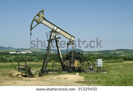 an oil pump is on a background mountains