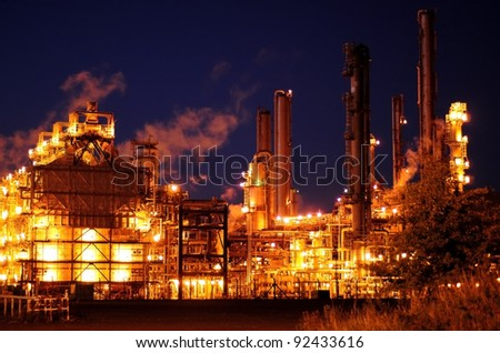 An oil refinery lit up at night.